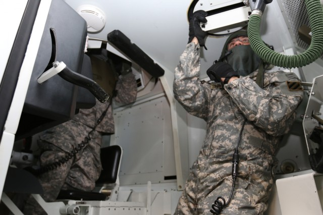 Armor crewman with B Company, 3rd Combined Arms Battalion, 67th Armor Regiment, 2nd Armored Brigade Combat Team, 3rd Infantry Division execute a crew fire command in the Close Combat Tactical Trainer tank simulator at Fort Stewart's Mission Training Complex Feb. 13, 2018. The training was used to improve the crews' level of armor proficiency as they convert to an armored brigade. (U.S. Army photo by Spc. Noelle E. Wiehe, 50th Public Affairs Detachment, 3rd Infantry Division)