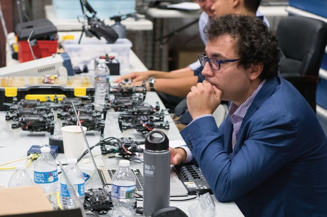 Dr. Giuseppe Loianno, a research scientist at the University of Pennsylvania, readies a self-navigating drone for a demonstration at ARL's Aberdeen facilities in August 2017. The demonstration was part of the MAST program, which gave participants from industry and academia the chance to work with ARL to explore technologies that would enable autonomous micro-robots to work together.