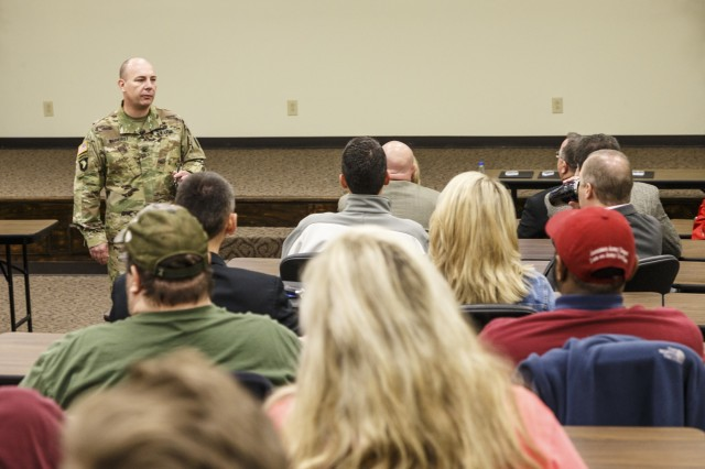 Anniston Army Depot Commander Col. Joel Warhurst speaks to employees during his Feb. 14 town hall session.
