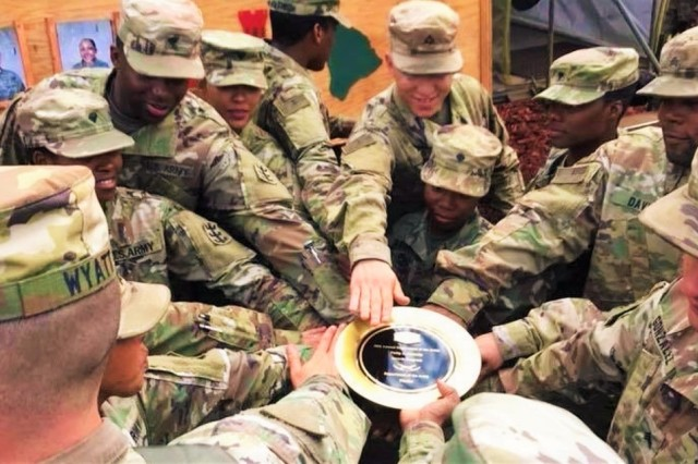 Soldiers of the Forward Support Company, 84th Engineer Battalion, the U.S. Army Pacific winners of the Philip A Connolly award, celebrate with the Gold Plate awarded to them by evaluators for making it to the Department of the Army level competition. Conducted on an annual basis, the Joint Culinary Center of Excellence administers the annual Philip A. Connelly Program in both field and garrison environments. The competition celebrates culinary excellence through the recognition of food service programs. (U.S. Army photo, 8th TSC Public Affairs)