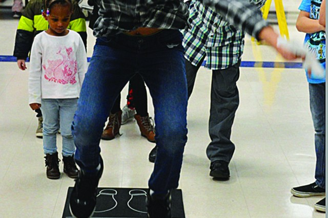 Malakhi Tuiloma sees how far he is able to jump during the Feb. 13 interactive STEM event at C.C. Pinckney Elementary School.