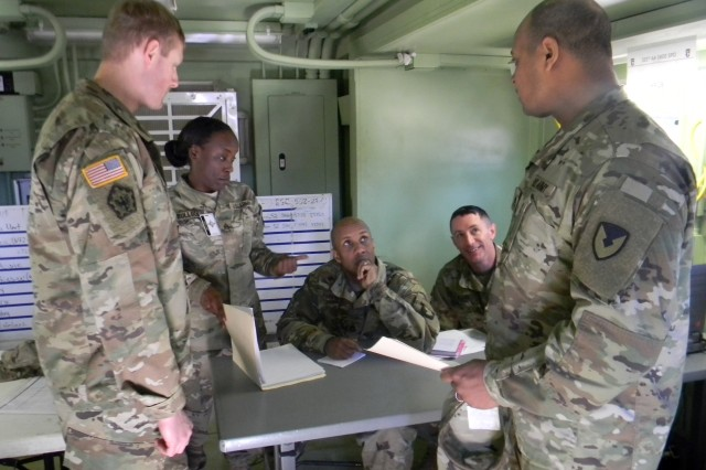 Capt. Derek Gibson, front left, and Staff Sgt. William Phipps discuss capability gaps with Soldiers from the 101st Sustainment Brigade during Warfighter Exercise 18-3 Feb. 9 at Fort Campbell, Kentucky. Gibson and Phipps are both assigned to the 741st Contracting Team at Fort Campbell.