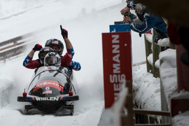 The U.S. men's bobsled team, which included Capt. Chris Fogt, completes a run during the men's bobsledding World Cup Dec. 7, 2013, at Utah Olympic Park in Utah. The team earned a gold medal during the event.