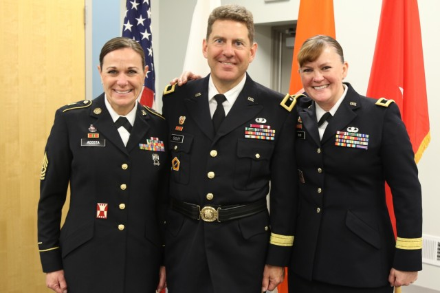 Army Reserve Brig. Gen. Matthew Easley, deputy commanding general of sustainment, 335th Signal Command (Theater) poses with Brig. Gen. Nikki Griffin-Olive, and Sgt. Maj. Brenda Acosta during his promotion ceremony at the Colorado State Patrol Training Academy, Golden, Colorado Jan. 6, 2018. The buckle traces back to World War I when all officers wore brown belts with an interlocking eagle plate in garrison. Today it is worn with the Army Combat Uniform for ceremonies and other events. It is seldom used to carry a sidearm. (U.S. Army Reserve photo by Capt. David Gasperson)