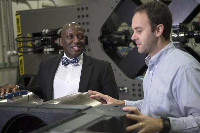 Dr. Jaret C. Riddick (left) speaks with Dr. Robert Haynes at the Vehicle Technology Laboratory at Aberdeen Proving Ground, Maryland.
