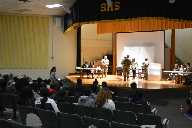 COLUMBUS, Ga. (Feb. 20, 2018) -- Students of the Officer Candidate School's Direct Commissioning Course began a partnership with Spencer High School in Columbus, Georgia, so that the high school students could learn about careers in law and military law. As part of the new partnership students of both the course and high school conducted a mock trial Feb. 9 at the high school. (U.S. Army photo by Bryan Gatchell, Maneuver Center of Excellence, Fort Benning Public Affairs)