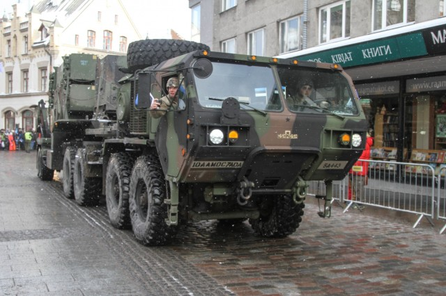 Spc. Deven Glenn, Spc. Brandon Smith, both Patriot Crewmembers assigned to Charlie Battery, 5th Battalion, 7th Air Defense Artillery drive a patriot Missile Launcher through Tallinn's Old Town towards Freedom Square in Estonia Feb. 24, 2018. The Patriot battery was invited to Estonia to participate and celebrate Estonia's 100th year anniversary.