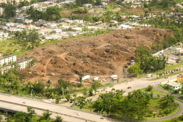 An aerial view of the Los Alamos debris site in Guaynabo, Puerto Rico. 50-80 truckloads of vegetative debris is hauled to this site each day to be mulched. 30-70 truck loads of mulch are hauled daily to the Toa Boa landfill to be used as cover.