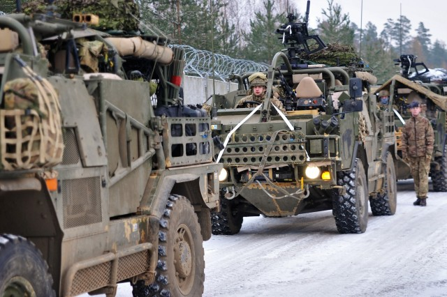 U.K. soldiers assigned to Light Dragoons, Balaklava Troop move vehicles to staging area in preparation of Exercise Puma, an exercise to test interoperability among the battle group and its higher headquarters, the Polish 15th Mechanized Brigade, at Bemowo Piskie Training Area, Poland, on Feb. 19, 2018.
