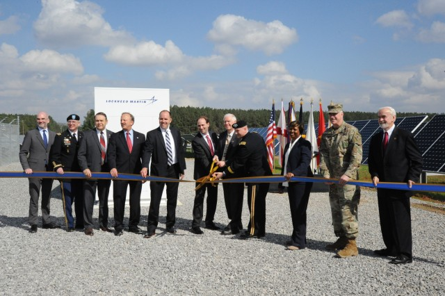 """Stakeholders cut the ribbon for the new 114-acre, renewable solar energy complex, located on Redstone Arsenal. The complex generates about 10 megawatt, alternating current, on-site solar renewable energy for the installation and its tenants. Cutting the ribbon are from left: Michael F. McGhee, Executive Director of the U.S. Army Office of Energy Initiatives; Col. Thomas Holiday, Redstone Arsenal garrison commander; Dave Tindoll, Installation Management Command South East Region Director; J.E. """"Jack"""" Surash, Acting Deputy Assistant Secretary of the Army (Energy and Sustainability); Nathan E. Griset, Director, SunPower Corps. Federal Sales Director, Jordan Gillis, Acting Deputy Assistant Secretary of the Army (Installations, Energy and Environment), Rep. Mo Brooks, Representative for Alabama's 5th Congressional District, Lt. Gen. Edward M. Daly, Army Materiel Command Deputy Commander, Brenda Johnson-Turner, U.S. Army Corps of Engineers, Col. John S. Hurley, U.S. Army Engineering and Support Center Huntsville commander and Joe Fitzgerald, Civilian Aide to the Secretary of the Army."""