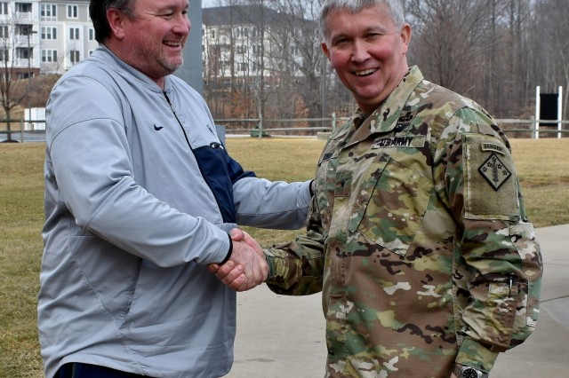 Rob Cooper, the head coach for the Penn State baseball team, shakes hands with Brig. Gen. James Bonner, commander of the 20th Chemical, Biological, Nuclear, Radiological, Explosives (CBRNE) Command to thank him for his presentation. The coaching staff of the Nittany Lions baseball team asked Bonner to speak on leadership during the team's visit to Ripken Stadium in Aberdeen, Md., Feb. 10.