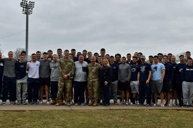 The Penn State baseball team takes a group photo with Brig. Gen. James Bonner, commander of the 20th Chemical, Biological, Nuclear, Radiological, Explosives (CBRNE) Command, his wife Debbie and his aide-de-camp, 1st Lt. Andy Harvey. The coaching staff of the Nittany Lions baseball team asked Bonner to speak on leadership during the team's visit to Ripken Stadium in Aberdeen, Md., Feb. 10.