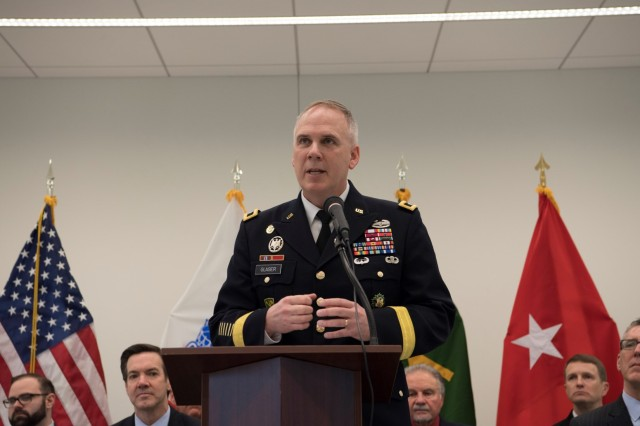 Provost Marshal General Maj. Gen. David P. Glaser addresses attendees of the Defense Forensics and Biometrics Agency's grand opening at the Biometric Technology Center in Clarksburg, W. Va., on Feb. 23, 2018.