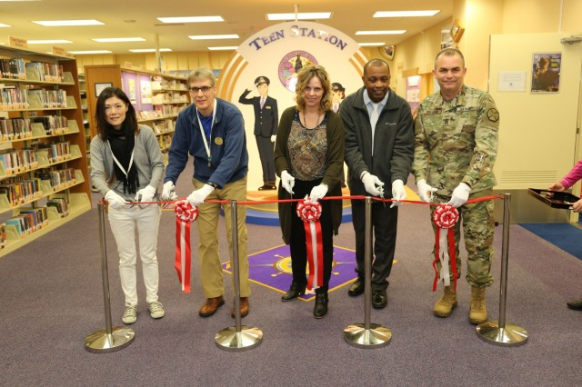 Command Sgt. Maj. Will Holland and personnel from Family and Morale, Welfare and Recreation, participate in a ribbon-cutting ceremony Feb. 22, 2018 to commemorate the Camp Zama Library Teen Station's grand opening. (U.S. Army photo by Lance D. Davis)
