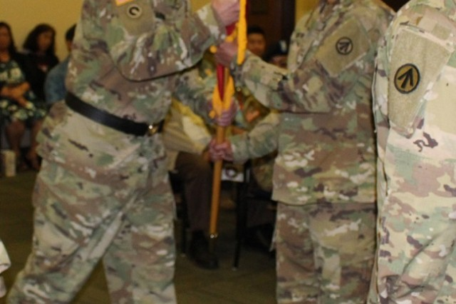 Maj. Gen. Stephen E. Farmen (left), passes the colors to Col. Frazariel I. Castro (right) during the 599th Transportation Brigade assumption of command ceremony February 26, 2018.  (Photo by Ruby Ragragola)