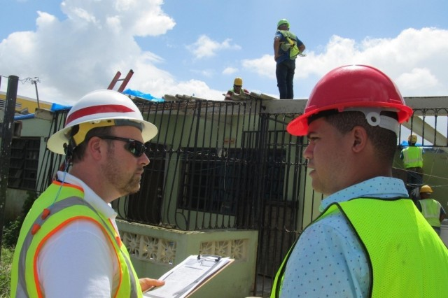 U.S. Army Corps of Engineers Deputy Resident Engineer Benjamin Bremer discusses Temporary Roof (Operation Blue Roof) installation with contractor quality control leader Samuel Ramos in Dorado, Puerto Rico on Feb. 22, 2018.Operation Blue Roof is a temporary repair intended to last 30 days and provides the homeowner the time and opportunity to secure a permanent fix.  To date, the Corps has installed over 58,000 blue roofs out of the 64,000 eligible requests on the island.
