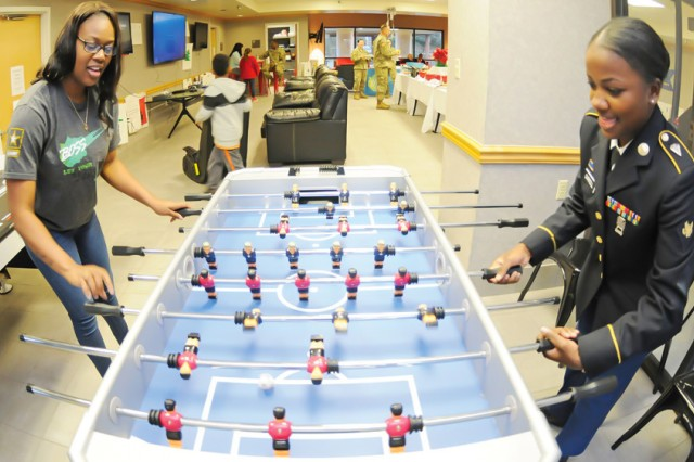 Pfc. Shyyandria Walker plays a game of foosball with Spc. Mykea Carroll Dec. 13, 2017, at the renovated Better Opportunities for Single Soldiers building at Fort Rucker, Alabama.  U.S. Army Garrison Fort Rucker took top prize in the 2018 Army Communities of Excellence competition for Regular Army installations.
