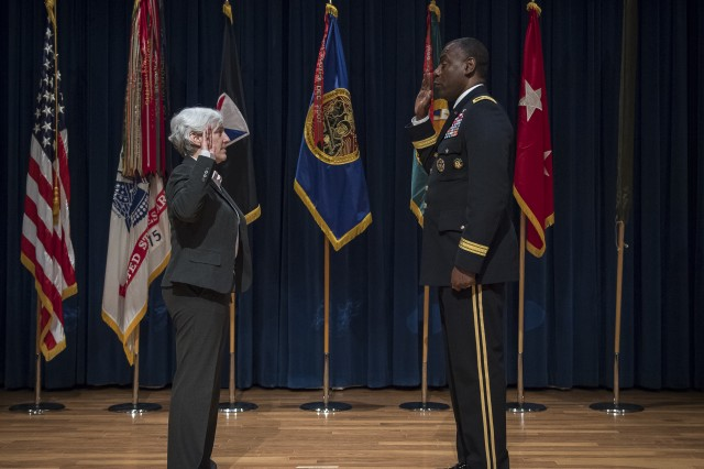 Maj. Gen. Cedric T. Wins (right), commanding general of the U.S. Army Research, Development and Engineering Command, hosts the swearing in of Cynthia (Cindy) M. Bedell into the Army's Senior Executive Service.