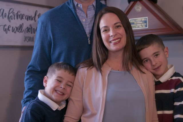 2018 Army Spouse of the Year recipient, Krista Anderson (center) poses for a photo surrounded by her family in her home in Olympia, Washington, Feb. 25. Anderson was selected out of the top 18 other military spouses from Army installations around the world. Anderson, a Gold Star Spouse and wife to a current active duty Green Beret from 1st Special Forces Group (Airborne), is now in the running for the overall Military Spouse of the Year for all military branches.
