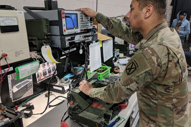 Pfc. Darius Hall from B Company, 210th Brigade Support Battalion, 2nd Brigade Combat Team, 10th Mountain Division, troubleshoots an AN/VRC-90 vehicular long-range radio before it is turned in to the supply support activity at Fort Drum, New York.