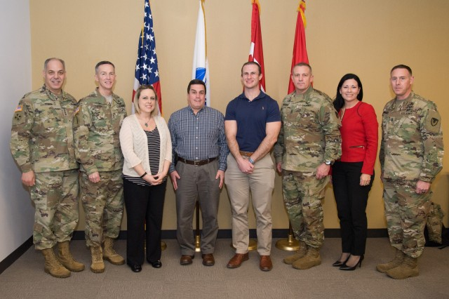 Pictured from left to right:  Gen. Gus Perna; Maj. Gen. Randy Taylor, CECOM Commanding General; Sarah Kovacs; Mike Brown; Michael Dooney; AMC Command Sergeant Major Rodger Mansker; Ms. Liz Miranda, Director, ILSC; and CECOM Command Sergeant Major Matthew McCoy.