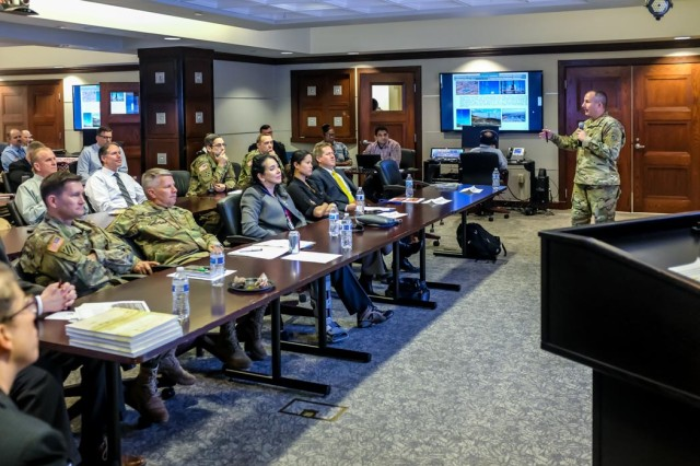Col. John Lloyd provides an update on power grid restoration in Puerto Rico resulting from the devastation caused by Hurricanes Irma and Maria in 2017 during the USACE Lunch 'n' Learn, a professional development activity conducted at the USACE headquarters during National Engineer Week, Feb. 17-24.