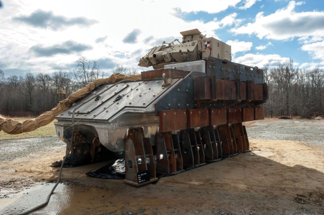 The forged BH&T, which BAE Systems worked rapidly to fabricate from the forged hull, complete with energy-absorbing seats, floors and crash dummies, sits on the test pad at the Aberdeen Test Center, Maryland, in December 2014, awaiting live fire testing.