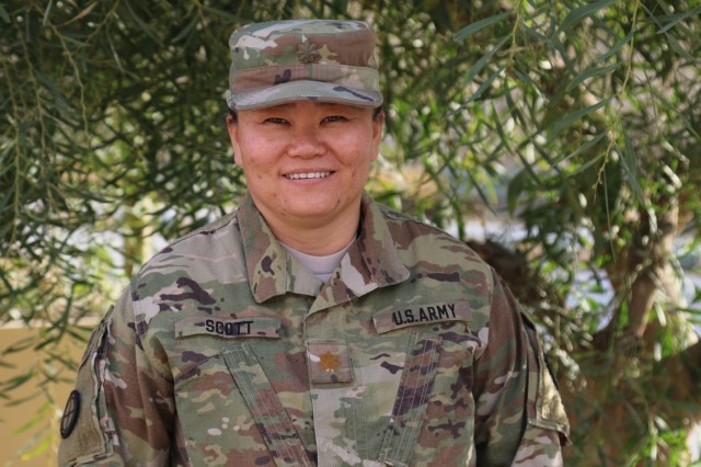 Army Maj. Kimberly Scott, the logistical planner and acquisition and cross-service agreement manager for the Army National Guard's 35th Infantry Division, first enlisted in the military after seeing how U.S. forces in South Korea helped orphans such as herself.