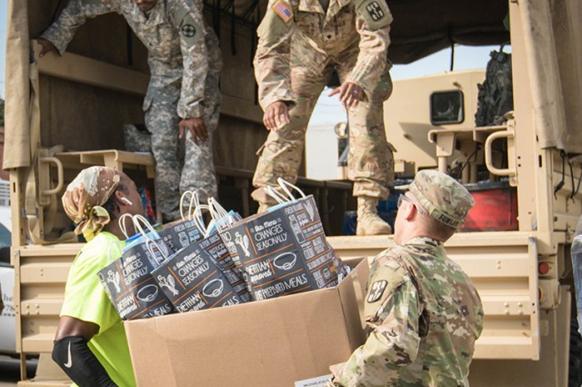 Soldiers assigned to 1st Medical Brigade and 13th Expeditionary Sustainment Command deliver food and water to Hurricane Harvey victims in Houston, Texas, on Sept. 5, 2017.