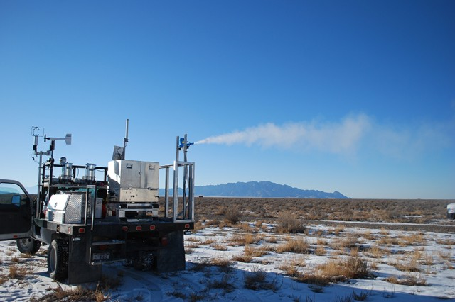 A vehicle-mounted disseminator releases simulated chemical agent on Dugway Proving Ground, Utah toward a distant detector. A faster-data, mobile system for testing chemical and biological agent detectors is expected this year. Photo by Joe Mashinski, U.S. Army