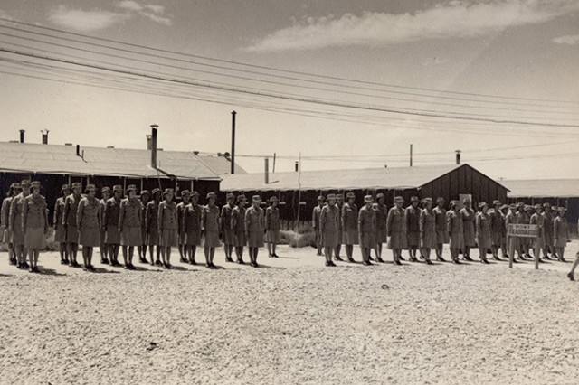 Formation of Women's Auxiliary Army Corps (WAAC) at Dugway Proving Ground, Utah in the 1940s. Dugway received the second Chemical Warfare Service WAAC unit in the nation (Pine Bluff Arsenal in Arkansas got the first), but the first unit in Utah was sent to Dugway. On April 20, 1943, 92 WAACS fell in a short distance from their new quarters, and marched in formation to their barracks -- as Soldiers. They replaced many male Soldiers as photographers, cooks, mechanics, meteorology and munitions observers, mortar operators and other jobs. No information on original print.