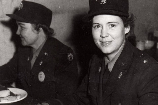 Two leaders of the Women's Auxiliary Army Corps (WAACs) at Dugway Proving Ground, Utah, in 1943. Facing: WAAC Commander 1st  Lt. Edna M. Short of Wheatland, Pennsylvania. Background: Short's assistant, 2nd Lt. Melissa Fiser Herrington of Morrilton, Arkansas. A detachment of 92 WAACs arrived at Dugway on April 20, 1943 -- the first such unit in Utah and one of the first in the nation. The corps was created to replace some men with women, to free the men for combat duty. Unknown photographer
