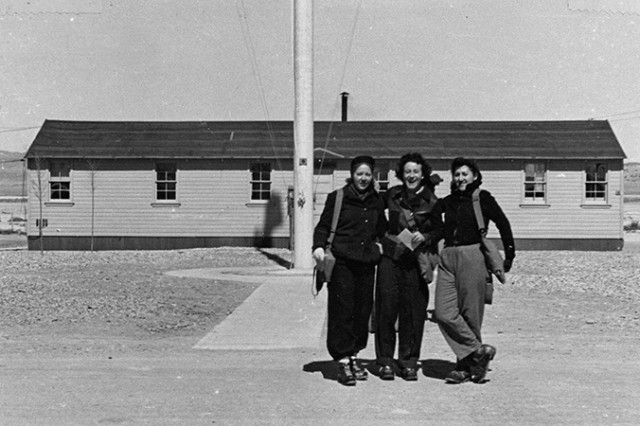 Unidentified WACs outside the headquarters building of Dugway Proving Ground, Utah. Original photo has 1943 to 1946 written on it, so this may be a 1946 photo and the women are being discharged to return home. The woman on the left may be Edna Short, commander of the first detachment of WAACs that arrived at Dugway in April 1943. Unknown photographer