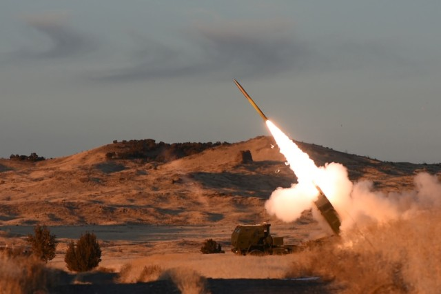 An M31A1 GPS-guided rocket leaves the M142 High Mobility Artillery Rocket System rocket launcher during Dec. 18, 2017 training by 4th Marine Division's 2nd Battalion, 14th Marine Reserve at U.S. Army Dugway Proving Ground, Utah. A Marine C-130 aircraft transports the HIMARS within firing range of compact targets, such as a meeting of enemy leaders. After firing, the vehicle returns to the C-130 and is flown out before the enemy can respond. Photo by Al Vogel, Dugway Proving Ground Public Affairs.