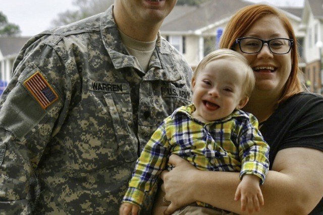 Georgia Guardsman Spc. Jason Warren smiles for a picture with his wife Cortney and son Lucas. Lucas was selected as the 2018 Gerber Spokesbaby.