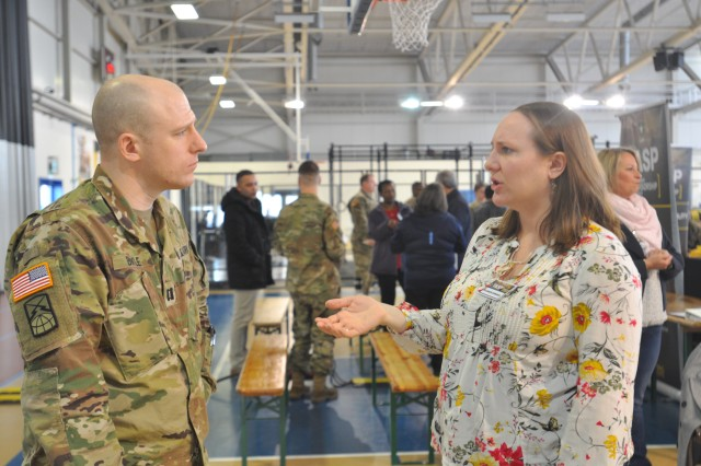 Eleanor Esparza (right), housing division chief at U.S. Army Garrison Benelux, talks to a Soldier during the Total Army Sponsorship Program Rodeo Feb. 23, 2018, on Chièvres Air Base, Belgium. Soldiers who are sponsoring incoming personnel came to the event to receive information from garrison organizations.