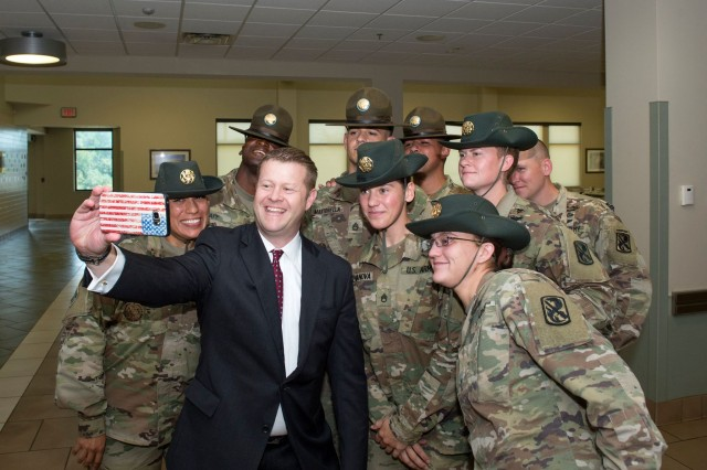 Under Secretary of the Army Ryan McCarthy takes a photo with a group of drill sergeants, Sept. 23, 2017. McCarthy recently visited the Combined Arms Center Training Facility, National Simulation Center at Fort Leavenworth, Kansas, Feb. 22, 2018, to discuss the Army's modernization efforts.