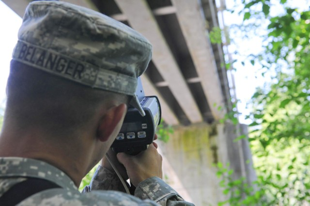 A combat engineer collects data with a reconnaissance and surveying equipment instrument set, or commonly referred as ENFIRE, during training June 5, 2013. The Army Corps of Engineers plans to deliver ENFIRE tool sets, which replace the old analog survey set and military field sketching kit, to its districts across the country by the end of this fiscal year.