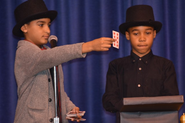 C.C. Pinckney students amaze the audience with magnificent performances at its annual Talent Show held in the school auditorium on Feb. 21. Fernando Torres and George Watlington perform a vanishing card trick that had audience members looking under their seats to locate the teleporting card. Talent show spectators also enjoyed various vocal renditions of popular songs and dance routines.
