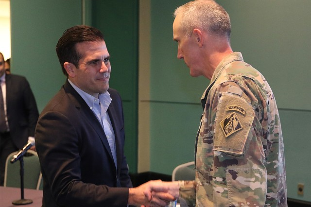 Task Force Power Restoration Commander, Col Jason Kirk, greets Puerto Rico Governor Ricardo Rossello preceding a meeting where Col. Kirk and Puerto Rico Electric Power Authority Acting Executive Director Justo Gonzalez delivered a presentation updating the current status and outlined the path forward for power grid resotration to Governor Rossello and mayors from across the island Feb.,28, 2018, at the San Juan Convention Center, San Juan, Puerto Rico. USACE continues to work in a unified effort with the Puerto Rico Power Authority, FEMA and industry partners to help people of Puerto Rico recover from this unprecedented disaster.