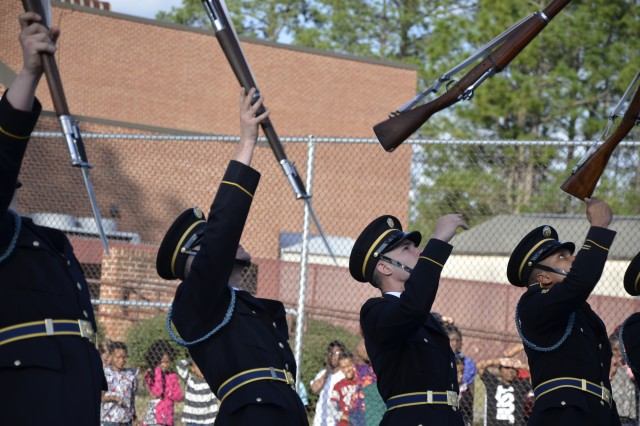 U.S. Army Drill Team members throw their bayonet-tipped 1903 Springfield rifles in the air during one of many breathtaking routines within their performance while visiting Fort Jackson Feb. 22.