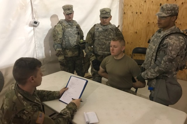 A Soldier with the 504th MI Brigade conducts an interview with a detainee role-player during combined training with Fort Hood's 89th Military Police Brigade at a training location in New Mexico.