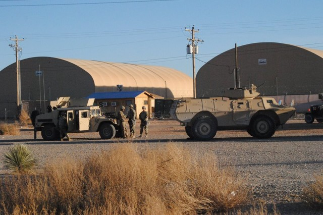 "Soldiers with the 89th Military Police Brigade prepare to depart in a military convoy at the McGregor Base Camp, New Mexico, during the ""Griffin Watch"" exercise."