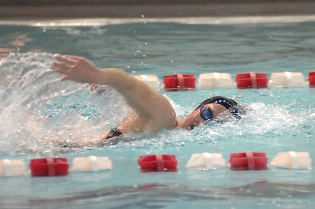 Grace Andrews, 554th Engr. Bn., competes in the 100-meter freestyle event. Andrews won the first heat with a time of 1:03.58.