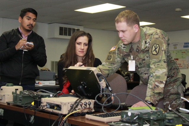 Staff Sgt. Jay Adkins (right) tests Joint Battle Command-Platform's new interactive multimedia instruction software as Patrick Rocha and Laura Phillips gather feedback at Fort Hood, Texas, on Dec. 12, 2017.