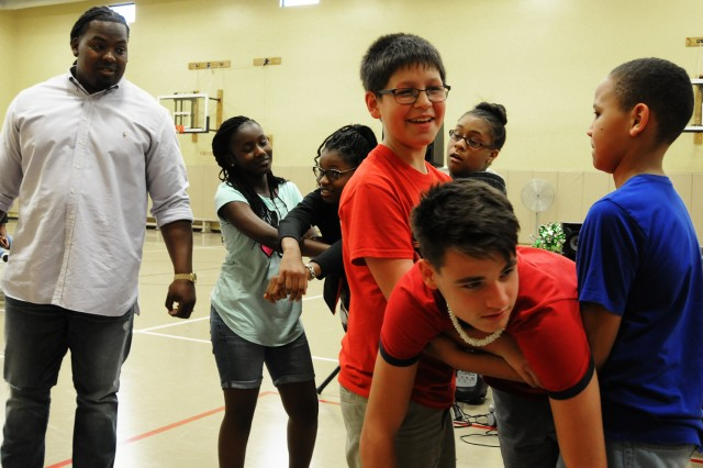 Steve McLendon, defensive tackle for the New York Jets, participates in a trust exercise with children at the Fort Rucker Youth Center during an anti-bully rally Feb. 23.