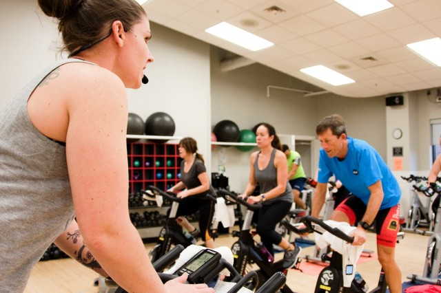 Nicole Crowley, fitness specialist, leads a recent class through an indoor cycling workout routine.