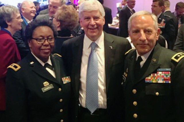 From left: Virgin Islands Adjutant General Brig. Gen. Deborah Howell, Michigan Gov. Rick Snyder and Michigan Adjutant General Maj. Gen. Gregory Vadnais at the National Governors Association reception in Washington, D.C., Feb. 24, 2018. The Virgin Islands and Michigan National Guards have developed a unique partnership to aid in hurricane recovery on the island.