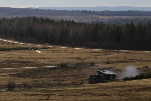 A M270 Multiple Launch Rocket System fires a rocket while conducting a simulated fires mission during exercise Dynamic Front 17 at the 7th Army Training Command in Grafenwoehr, Germany, Mar. 6, 2017. Range Operations at 7ATC's GTA coordinates infantry, engineer, armor and aviation activities during exercises like Dynamic Front 18.