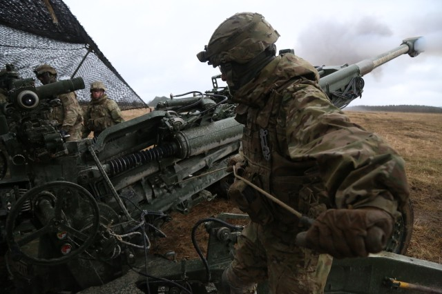 A U.S. Soldier of 2nd Cavalry Regiment fires an M777 Howitzer while conducting fire missions during exercise Dynamic Front 17 at the 7th Army Training Command in Grafenwoehr, Germany, Mar. 6, 2017. Range Operations at 7ATC's GTA coordinates infantry, engineer, armor and aviation activities during exercises like Dynamic Front 18.